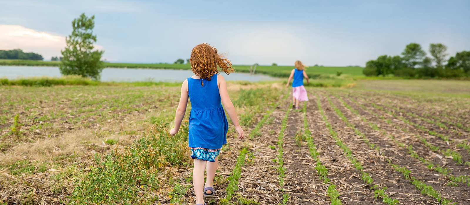 Young girls in newly planted field