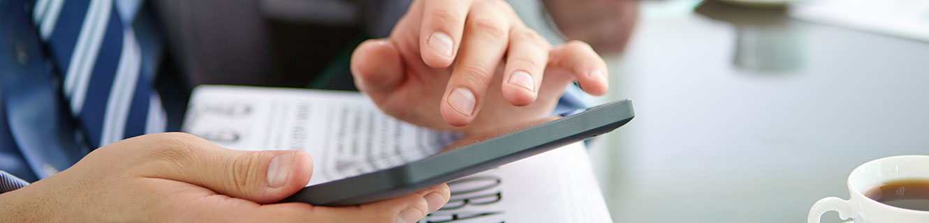 A man touching the screen of his mobile device.