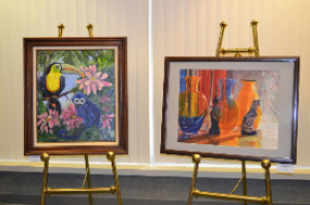 Two of Sandy Hall's paintings on easels